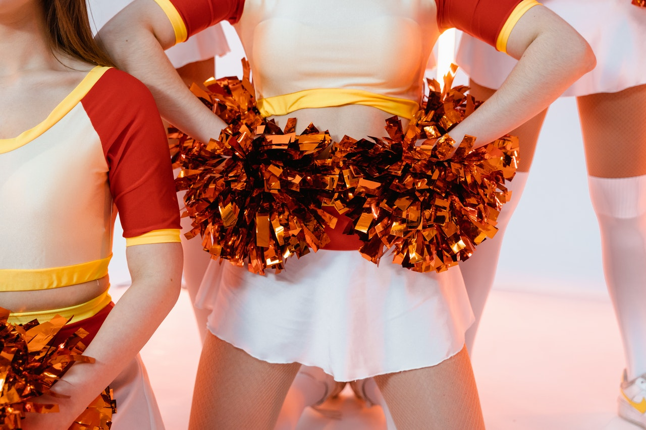 Why are cheerleading uniforms so short?