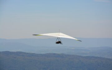 What is safer, hang gliding or paragliding?